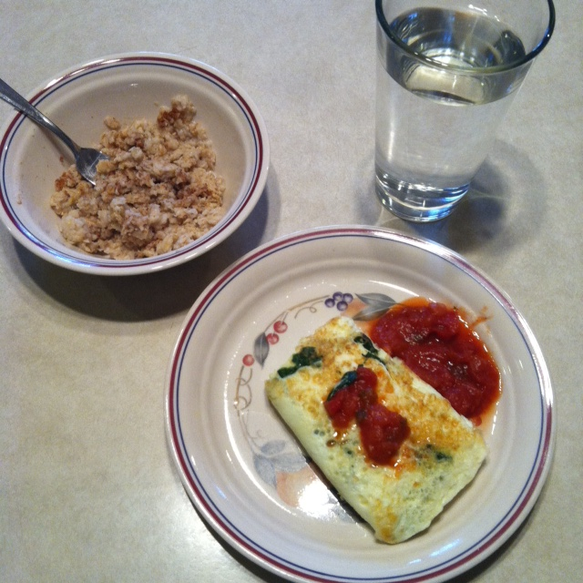 Standard breakfast: Egg white omelette with spinach and salsa, with a side of oatmeal.