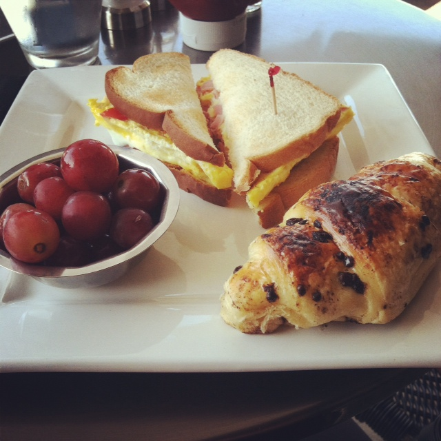 Ham and Egg Breakfast Sandwich with Chocolate Croissant and Grapes